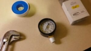 Remove pressure gauge from well pump